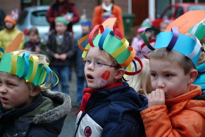 Kinderen bij een vorig bezoek van Sinterklaas aan basisschool Don Bosco in Renkum.
