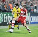 Een jonge Philipp Lahm in duel met een jeugdige Lionel Messi.