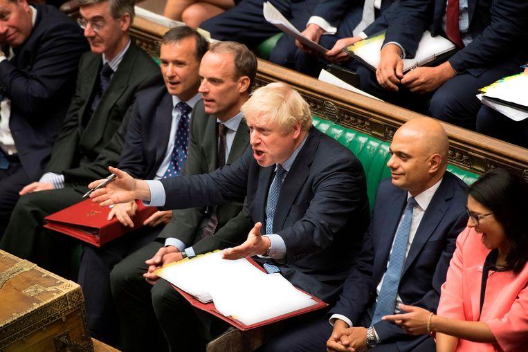 De Britse premier Boris Johnson gisteren in het parlement. Beeld AFP
