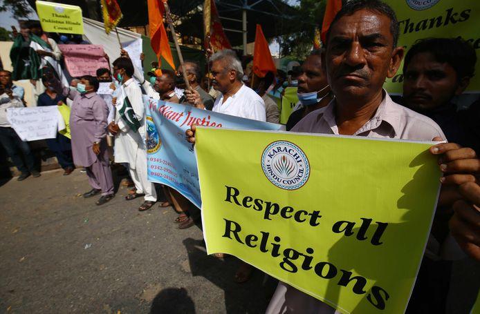 Hindoes vragen respect voor hun religie tijdens een protestmars in Karachi gisteren.
