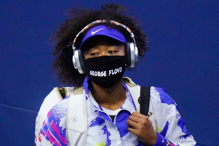 Naomi Osaka, hier met een mondkap waar George Floyd op staat, de man die door de politie werd vermoord. Beeld AP