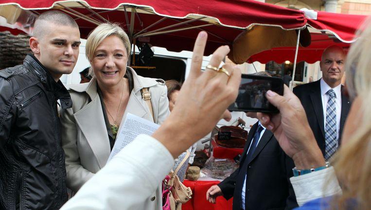 Marine Le Pen van het Front National op campagne in Ajaccio, op het eiland Corsica. Beeld AFP