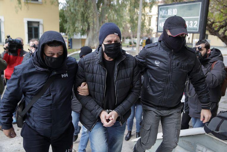 Lignadis werd geboeid meegenomen. Beeld REUTERS
