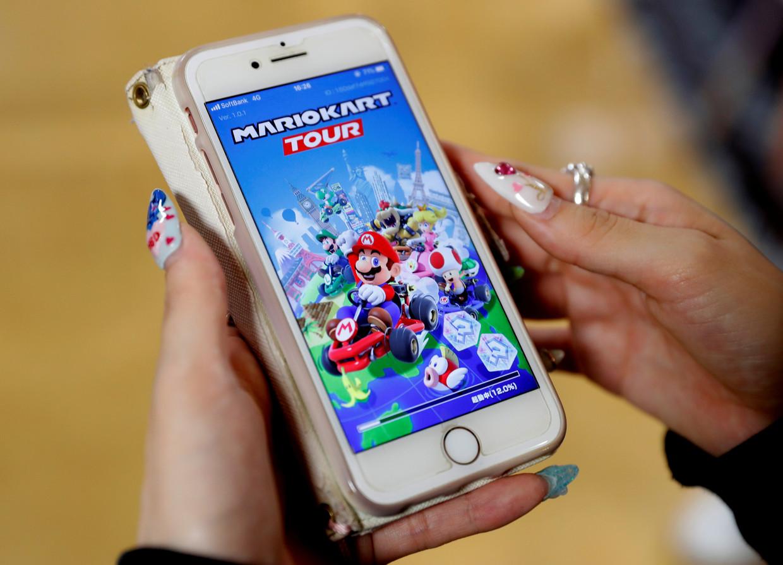 Mario Kart Tour - een vereenvoudigde versie van het bekende racespel met Mario - is een van de succesvolste mobiele spellen. Beeld Reuters