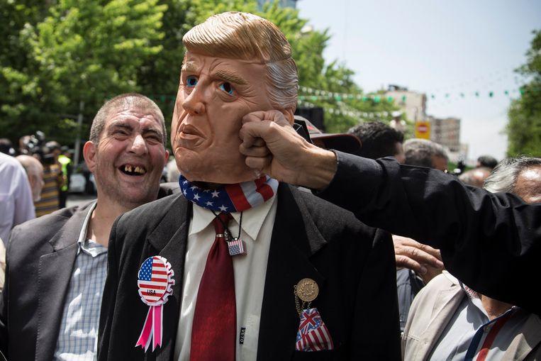 President Trump wordt te kijk gezet op een anti-VS-betoging in Teheran. Beeld Photo News