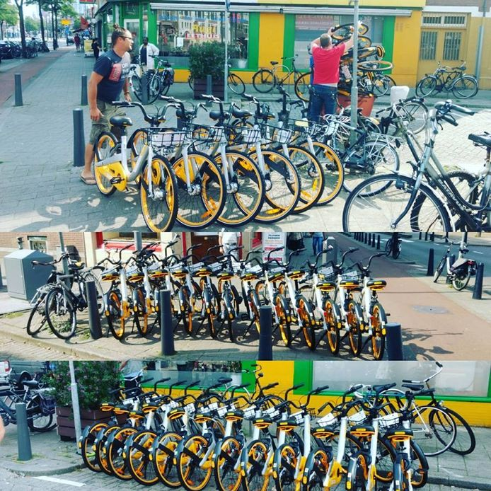 De mensen van Mooi Mooier Middelland verplaatst de fietsen van zijstraatjes waar ze in de weg staan, naar een parkeerplek op de Middellandstraat .