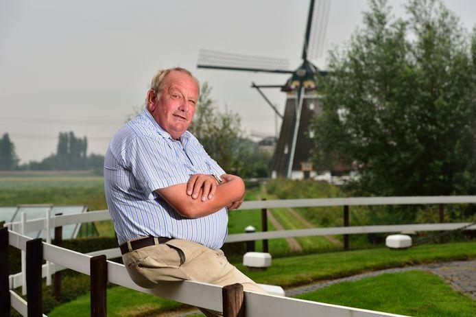 Molenaar Johan Ottevanger bij de molenviergang.