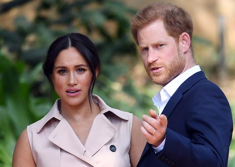 Prins Harry en zijn vrouw Meghan. Beeld EPA