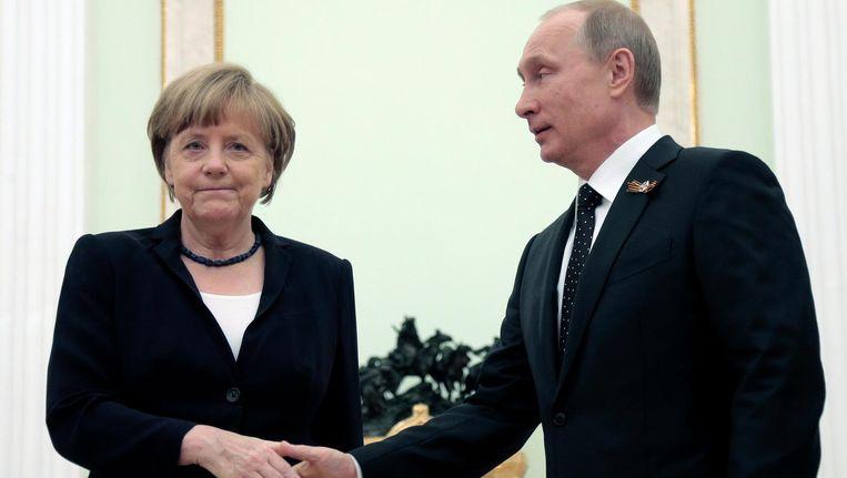 Merkel en Poetin. Beeld epa