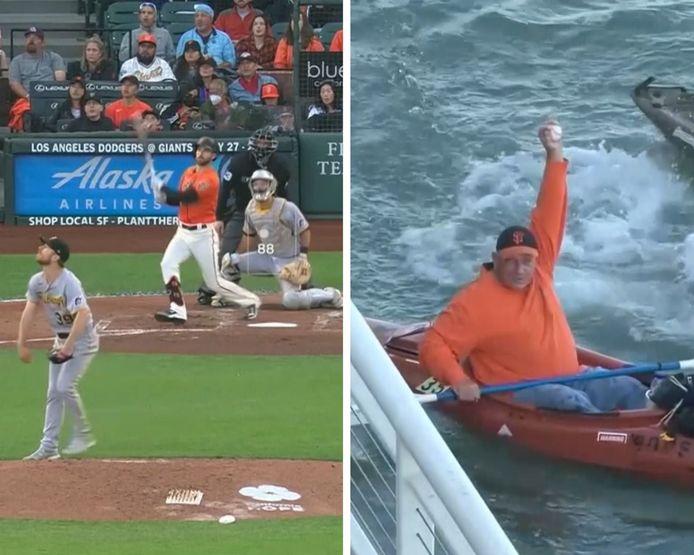 Des fans se battent pour une balle de Home run après un plongeon dans la baie de San Francisco McCovey Cove.