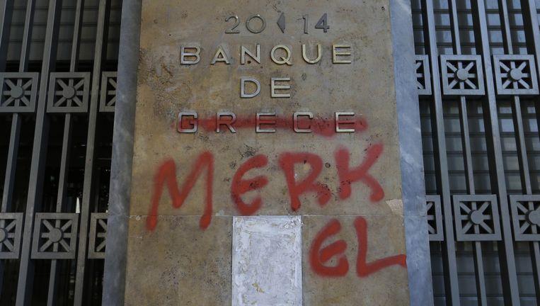 Bekladde deur van een Griekse bank in Athene. Beeld AP