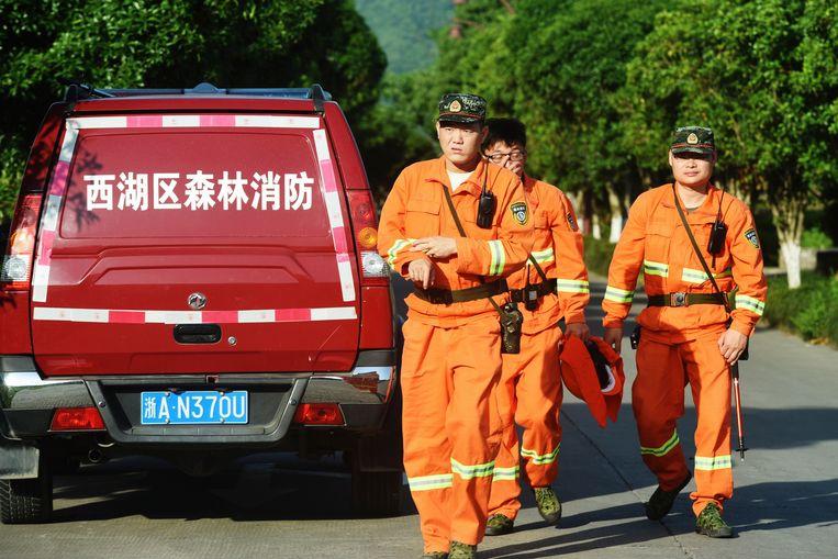 Er wordt rondom Hangzhou  nog altijd gezocht naar één van de drie ontsnapte luipaarden.  Beeld AP