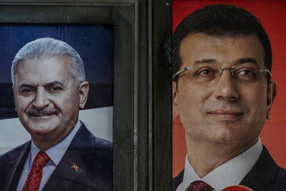 Verkiezingsposters van kandidaten Binali Yildirim van regeringspartij AKP en Ekrem Imamoglu van de seculiere oppositie