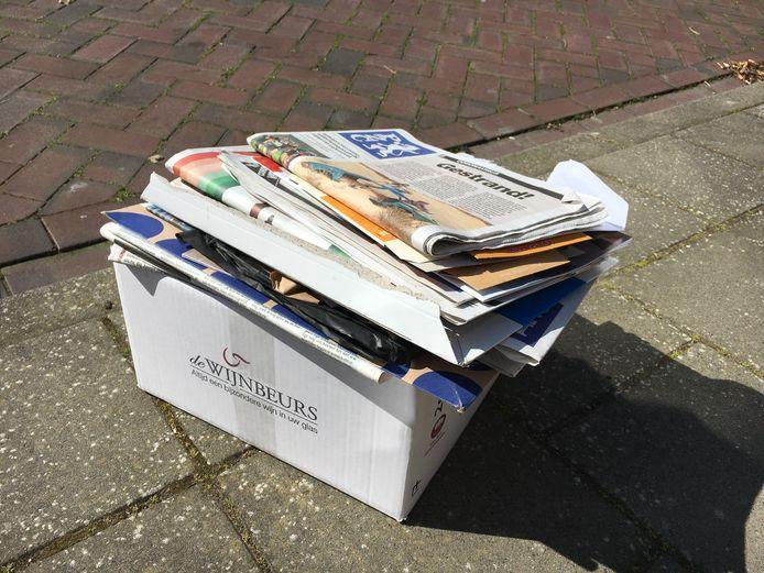 Zet het oud papier vroeger aan de straat.