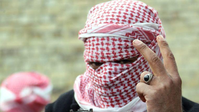 Strijders van de Islamitische Staat in Irak en de Levant (ISIL) in Fallujah. Beeld epa