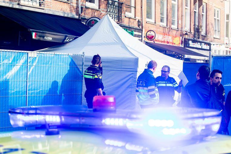 Hulpdiensten op het Hugo de Grootplein na de schietpartij van 23 oktober 2019. Beeld ANP