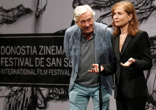 Paul Verhoeven met hoofdrolspeelster Isabelle Huppert