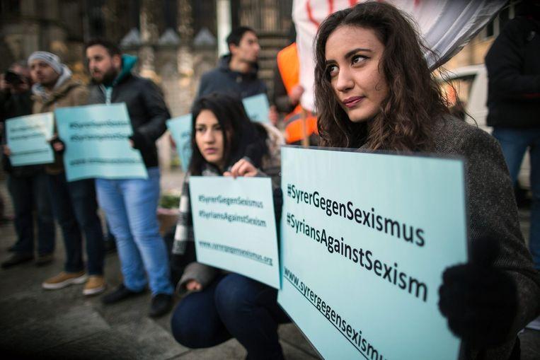 Syriërs die demonstreren tegen het seksuele geweld in Keulen. Beeld anp