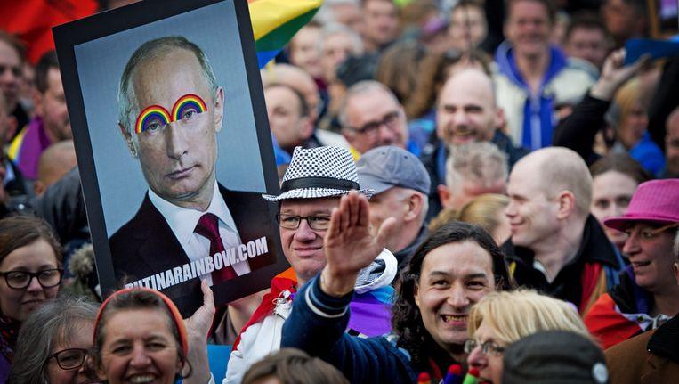Demonstranten tegen de Russische antihomowet bij het Scheepvaartmuseum in Amsterdam afgelopen april. Beeld anp