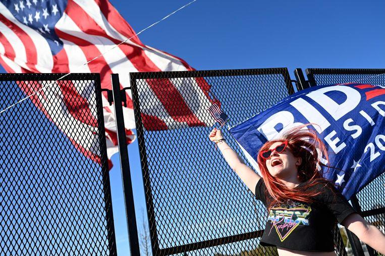 Een Biden-fan in Wilmington, Delaware. Beeld AFP