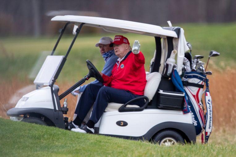 Trump op zijn golfbaan in Virginia, USA. Beeld EPA