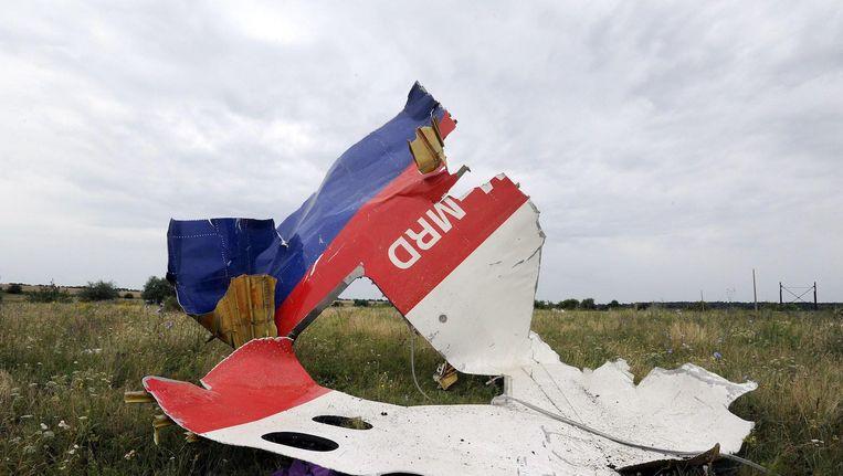 Een wrakstuk van het neergehaalde vliegtuig, drie jaar geleden in een weiland in het Oekraïense Shaktarsk. Beeld afp