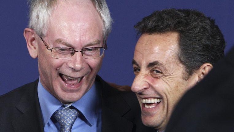 Herman Van Rompuy samen met de Franse president Sarkozy, ontlading na de spanning van de voorbije weken. Beeld UNKNOWN