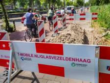 Letterlijk begraven onder KPN-kabels: T-Mobile vraagt Den Haag om blokkade 'onnodig' netwerkaanleg