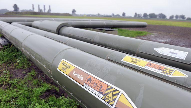 Bovengrondse leidingen van de NAM bij Schoonebeek. Beeld ANP