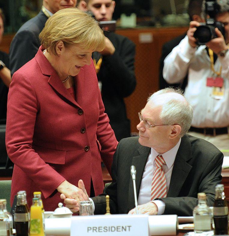 Merkel en Herman Van Rompuy, in 2010 in Brussel. Van Rompuy: 'Met de migratiedeal met Turkije heeft ze Europa voor een crisis behoed.' Beeld IMAGEGLOBE
