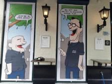 Ludieke prenten op rolluiken biercafé passen niet bij 'beschermd dorpsgezicht' van Vught en moeten weg