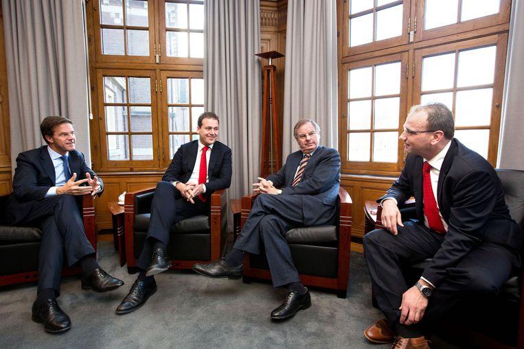 Mark Rutte in (VVD)2012 met Lodewijk Asscher (PvdA), Bernard Wientjes (VNO-NCW) en Ton Heerts (FNV). Beeld Hollandse Hoogte / Novum RegioFoto