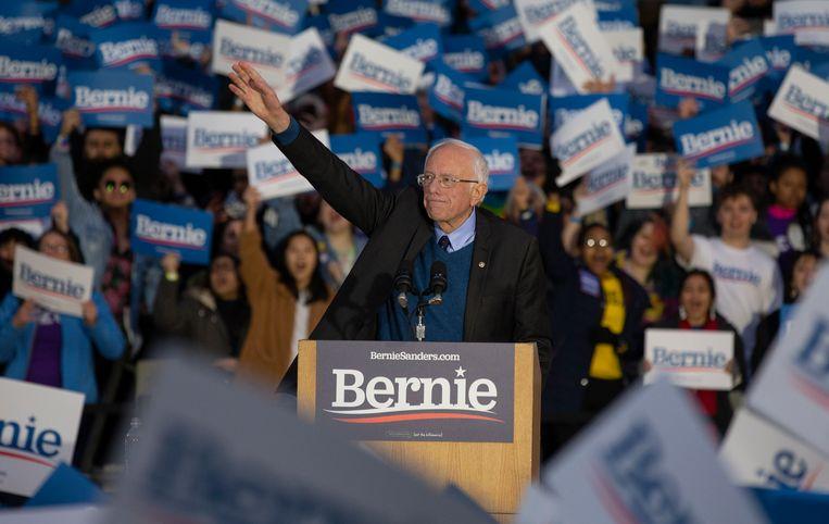 Bernie Sanders deze week op een verkiezingsbijeenkomst op de University of Michigan.  Beeld EPA