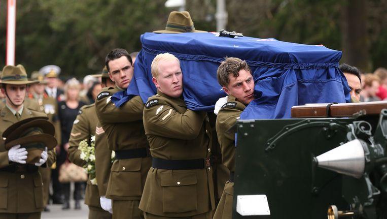 Begrafenis van één van de militairen. Beeld getty