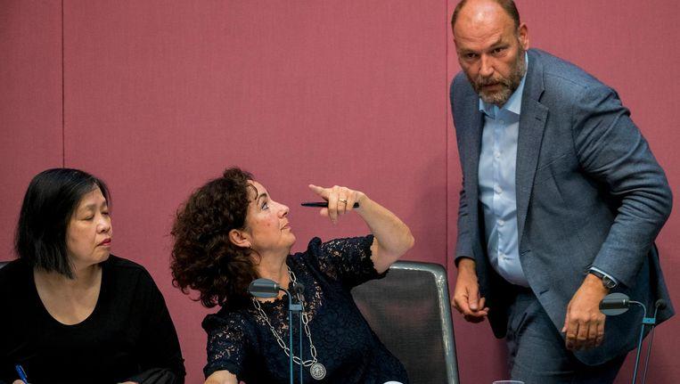 Wethouder Groot Wassink, met naast hem burgemeester Halsema en raadsgriffier Marijke Pe. Beeld anp