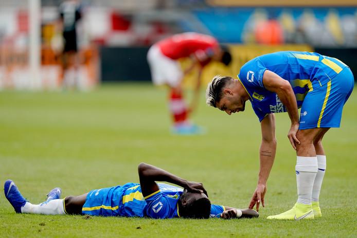 Darren Maatsen (op de grond) en Paul Quasten.