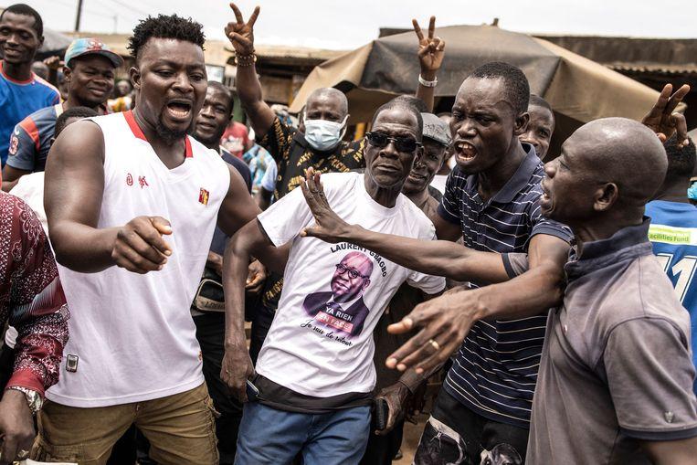 Aanhangers van Laurent Gbabo vieren feest in de straten van Ivoorkust vanwege zijn terugkeer.  Beeld AFP