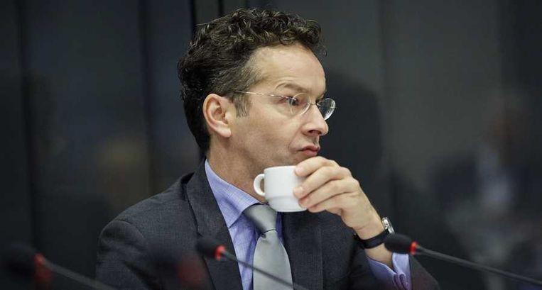 Minister Jeroen Dijsselbloem van Financiën: 'Natuurlijk is het teleurstellend dat deze rating naar beneden is bijgesteld. Ik verwacht overigens geen wezenlijk effect op de rente. Je ziet dat de markt al heeft geanticipeerd.' Beeld anp