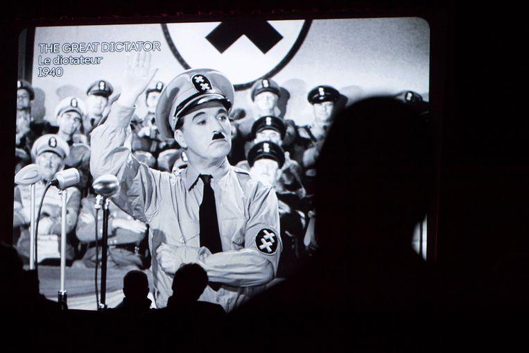Charlie Chaplin in 'The Great Dictator'. Geraldine: 'Mijn vader had die film nooit gemaakt als hij wist welke misdaden Hitler had begaan.' Beeld AP