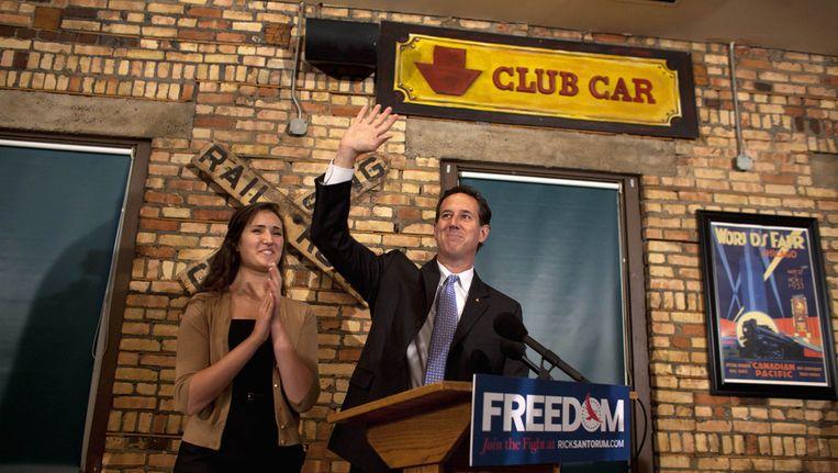 Rick Santorum viert zijn overwinning in Louisiana. Beeld reuters