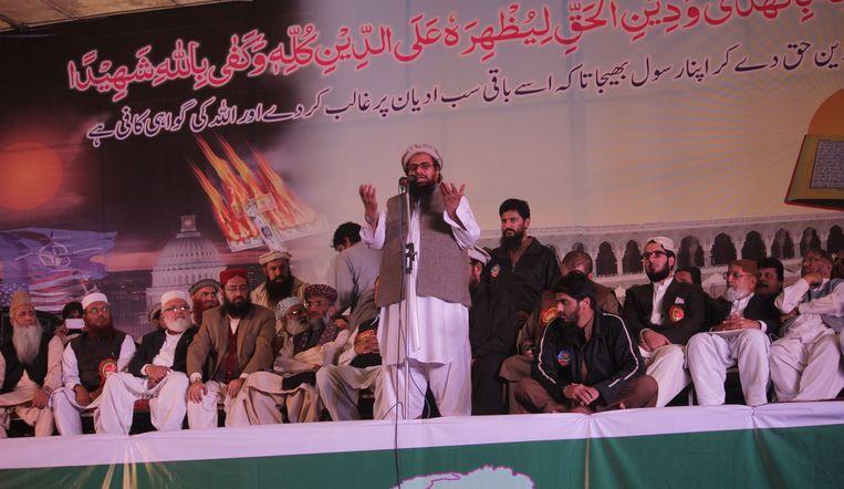 Hafiz Saeed spreekt tijdens een conventie in Lahore (Pakistan) in 2014. Beeld Getty