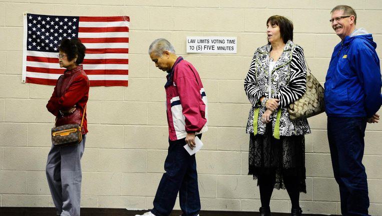 Kiezers staan in de rij om te stemmen in Wichita, Kansas (2012). Beeld epa