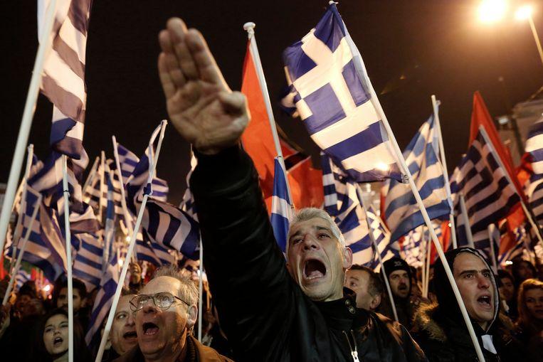 De partijleider van Gouden Dageraad, Nikos Michaloliakos, en de meeste andere veroordeelden, zitten in Griekenland in de gevangenis.   Beeld AP