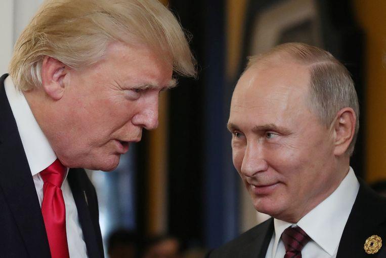 Donald Trump en Vladimir Poetin in november vorig jaar. Beeld AFP