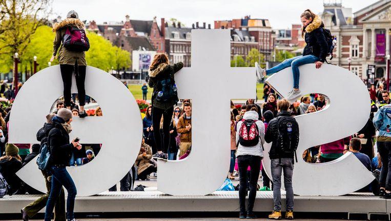 Stop met het framen van de drukte als 'het succes van de stad', vindt Arjan Welles. Beeld Robin Utrecht/ANP