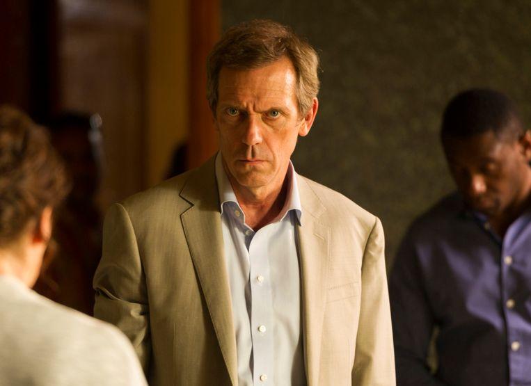 Hugh 'Dr. House' Laurie werd genomineerd voor een Golden Globe voor zijn bijrol in deze 'The Night Manager' Beeld AP