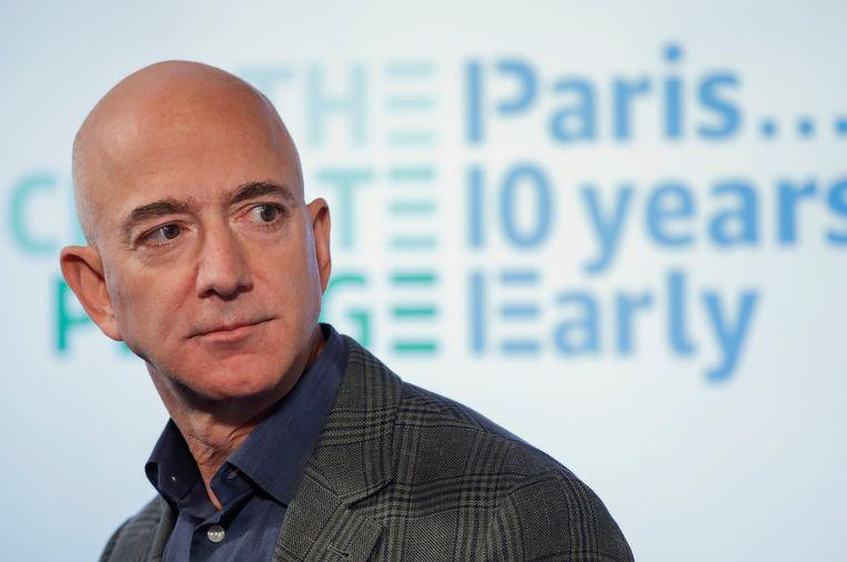 Jeff Bezos krijgt van zijn bedrijf Amazon het bescheiden jaarsalaris van omgerekend 65.000 euro. 'Een klassieke slimmigheid.' Beeld AP