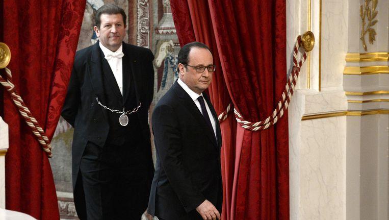 Hollande in het Elysée, voor hij zijn toespraak hield. Beeld reuters