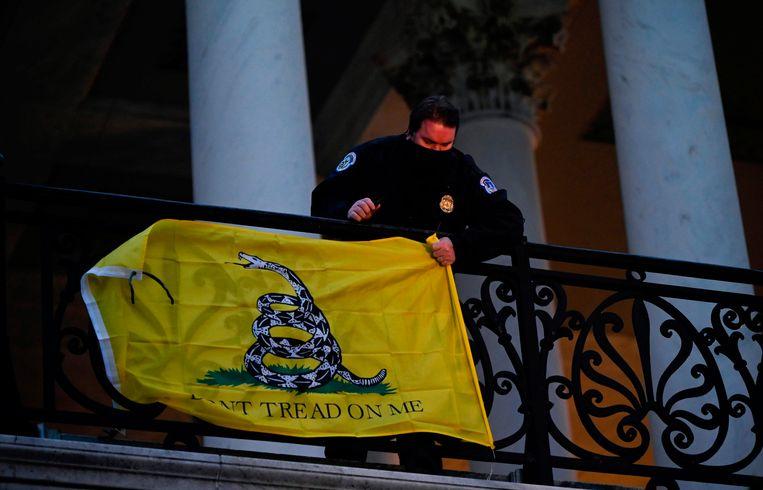 De Gadsden-vlag met een ratelslang die waarschuwt: Vertrap mij niet. Beeld AFP
