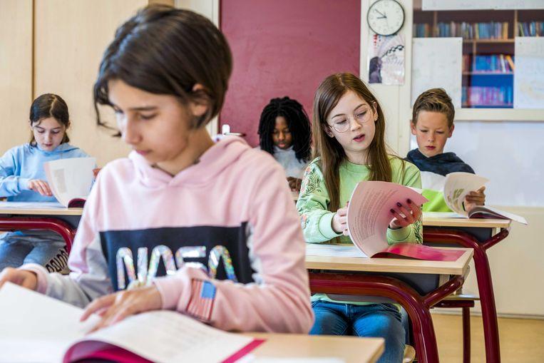 Leerlingen in de klas. Komen er straks op alle scholen CO2-meters? Beeld ANP